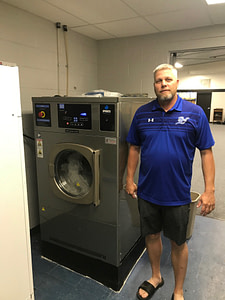 Athletes on the field protected from infection with Sports Laundry Systems, the best commercial washer and dryer