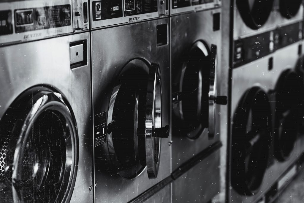 grayscale-photo-of-washing-machine-22540651