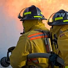 An image of firefighters fighting a fire.