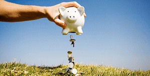 Background image of piggy bank linking to financing page