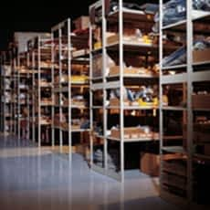 Shadowy image of parts racks in a warehouse.