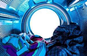 An image of clothers inside of a washer taken from inside the washing machine drum.